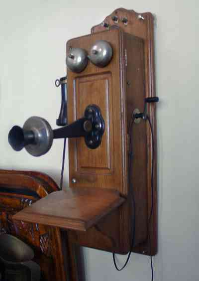 Pensacola:-Seville-Historic-District:-BW-Properties_18.jpg:  folk victorian home, crank wall telephone, kitchen