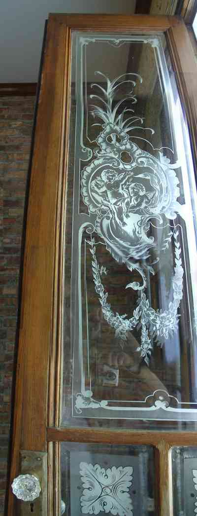 Pensacola:-Seville-Historic-District:-BW-Properties_20.jpg:  etched glass door panel, cafe doors, glass door knob