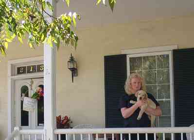Pensacola:-Seville-Historic-District:-Chloe-And-Sophies-Attic_07.jpg:  victorian cottage, puppy, porch, antique shop,