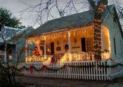 Pensacola:-Seville-Historic-District:-Chloe-And-Sophies-Attic_11.jpg:  christmas decorations, picket fence, pecan tree, garland, christmas tree