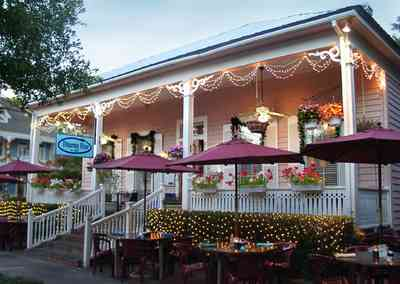 Pensacola:-Seville-Historic-District:-Dharma-Blue-Restaurant_02.jpg:  christmas decoratiions, garland, restaurant,petunias