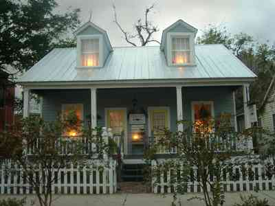 Pensacola:-Seville-Historic-District:-Estate-Jewelry_03.jpg:  picket fence, candles, wreath, victorian gulf coast cottage