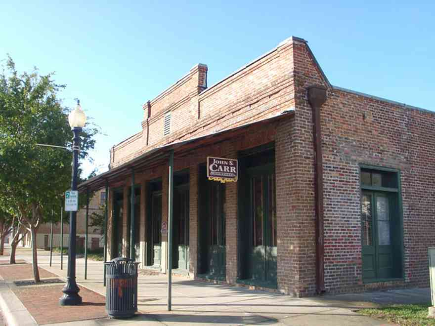 Pensacola:-Seville-Historic-District:-John-Carr-Company_01.jpg:  storefront building, real estate developer, brick building, brick sidewalk