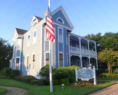 Pensacola:-Seville-Historic-District:-Kerrigan,-Estees,-Rankin,-McLeod-Law-Offices_00.jpg:  american flag, victorian house, law office
