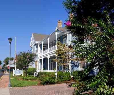 Pensacola:-Seville-Historic-District:-Kerrigan,-Estees,-Rankin,-McLeod-Law-Offices_02.jpg:  crepe myrtle tree, victorian house, gallery, porch, balcony