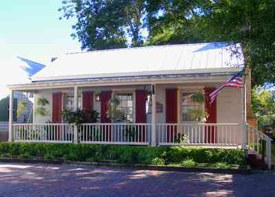 Pensacola:-Seville-Historic-District:-Lisa-Minshew-Attorney_01.jpg:  creole cottage, historic district, american flag, porch