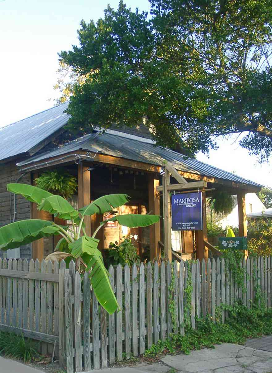 Pensacola:-Seville-Historic-District:-Mariposa-Gallery_03.jpg:  art gallery, picket fence, banana tree