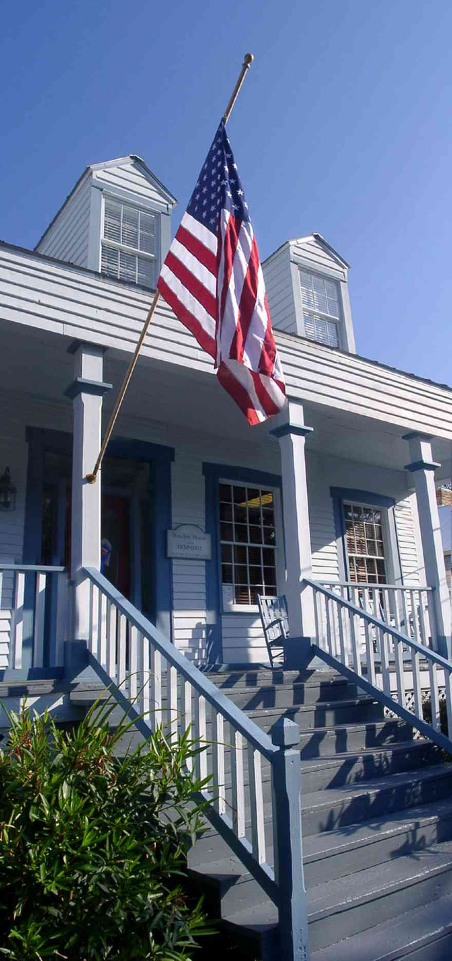 Pensacola:-Seville-Historic-District:-Michles-And-Booth-P.-A._0.jpg:  american flag, creole cottage, victorian cottage