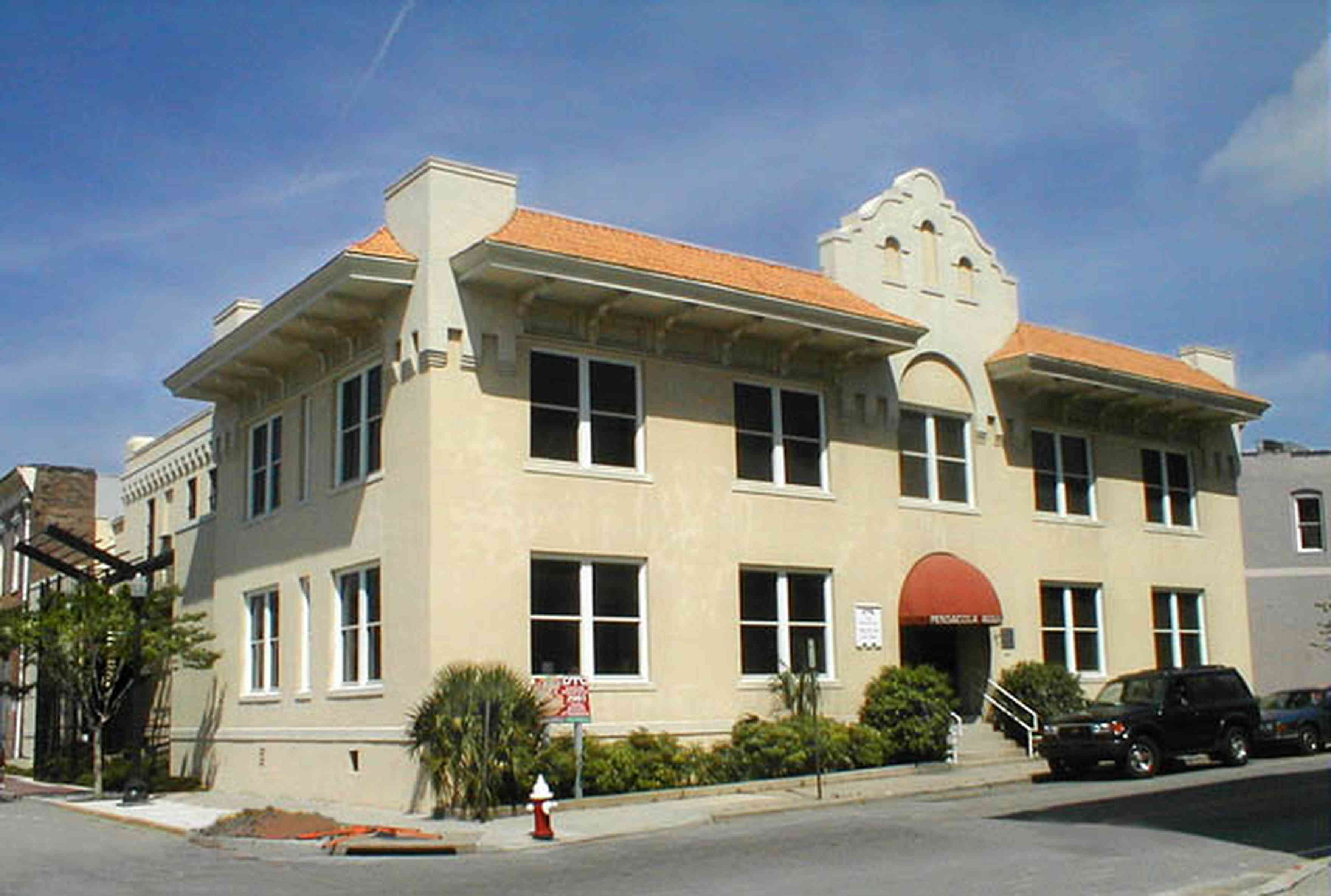 Pensacola:-Seville-Historic-District:-Old-City-Jail_00.jpg:  classical architecture, beaux arts architectural style, spanish revival architecture, art museum, awning, downtown, stucco, bars, jail, prisoners, incarceration