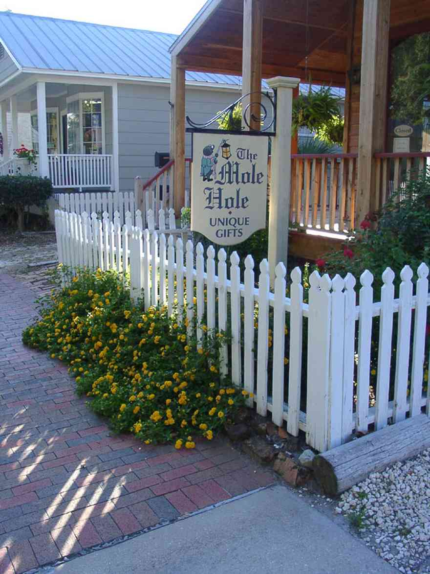 Pensacola:-Seville-Historic-District:-The-Mole-Hole_01.jpg:  picket fence, shop, shotgun cottage, historic district