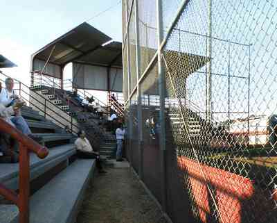 Pensacola:-Tate-High-School_02.jpg:  stadium, ball field, patrons, audience, mesh fence, shelter, gonzales, escambia county