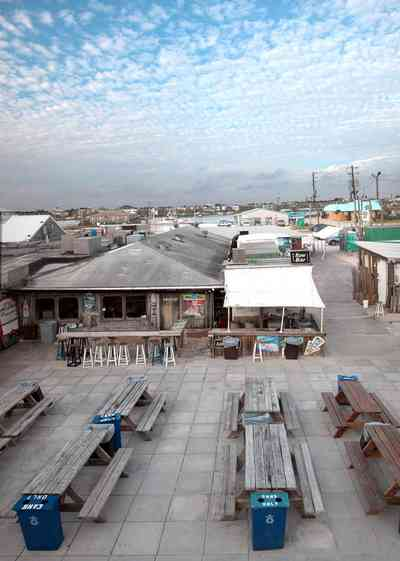 Perdido-Key:-Flora-Bama-Lounge_02a.jpg:  bar, lounge, mullet toss, picnic tables, tent
