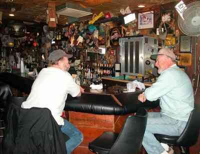 Perdido-Key:-Flora-Bama-Lounge_04.jpg:  bar patrons, waitress, bartender, bottles, fam, bar stools, song writers