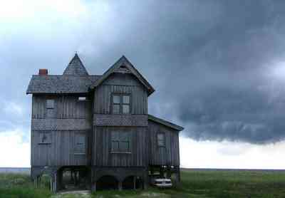 Perdido-Key:-Gothic-House_04.jpg:  gothic house, victorian house, beach, dunes, storm, gable, gingerbread trim, gulf of mexico