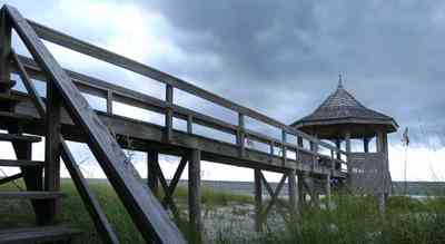Perdido-Key:-Gothic-House_07.jpg:  gazebo, beach, dune, sand, sea oats, steps, deck, pier, gulf of mexico, cumulus cloud, storm, beach