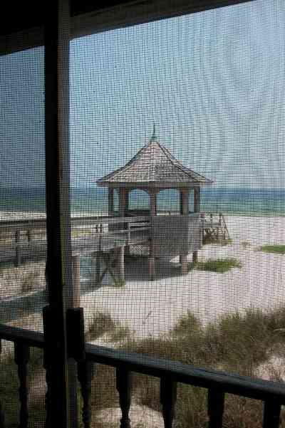 Perdido-Key:-Gothic-House_08d.jpg:  porch, screen porch, summer house, gazebo, cedar shake roof, walkway, pier, deck, gulf of mexico, emerald water, dunes, sea oats, beach