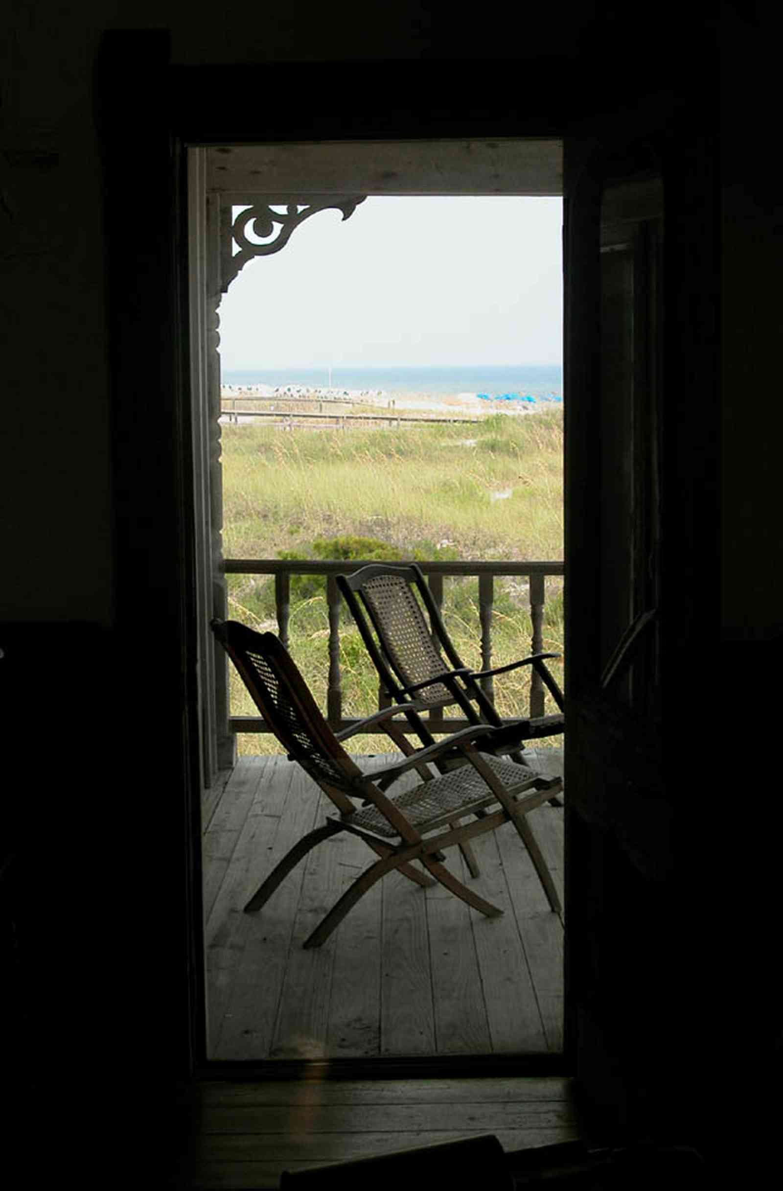 Perdido-Key:-Gothic-House_08f.jpg:  porch, screen porch, summer house, gazebo, cedar shake roof, walkway, pier, deck, gulf of mexico, emerald water, dunes, sea oats, beach, deck chairs, doorway