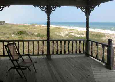 Perdido-Key:-Gothic-House_08g.jpg:  porch, deck, deck chairs, gothic architecture, dunes, white sand, gulf of mexico, perdido key, escambia county, weathered wood, rough wood, newel post