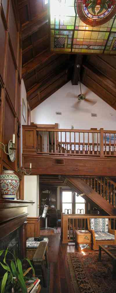 Perdido-Key:-Gothic-House_08jj.jpg:  great room, wooden floors, heartpine, oriental rug, gothic architecture, candle sconce, dining room, living room