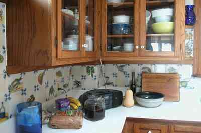 Perdido-Key:-Gothic-House_08l.jpg:  kitchen, ceramic tile, heartpine cabinet, knicknacks