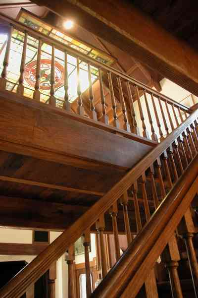 Perdido-Key:-Gothic-House_08r.jpg:  staircase, heartpine lumber, skylight, stained glass window