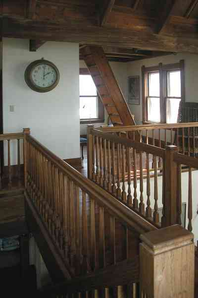 Perdido-Key:-Gothic-House_08t.jpg:  staircase, ship's clock, second floor, heartpine lumber,