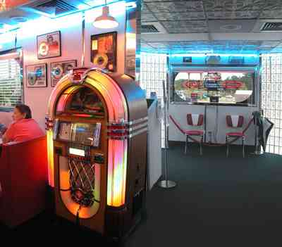 Pine-Forest:-50s-Diner_06.jpg:  juke box, diner, stainless steel, rainbow juke box, malts, hamburgers