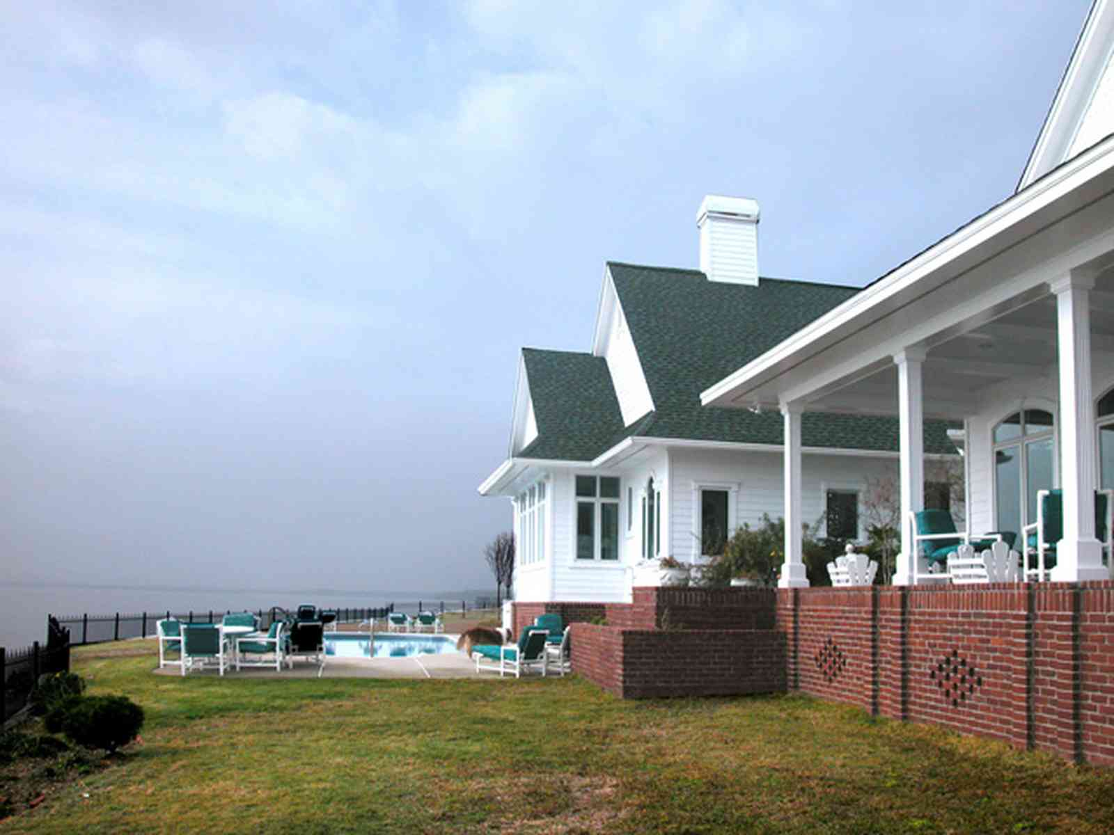 Sanders-Beach-585-Windrose_02+web.jpg:  waterfront home, gabled roof,