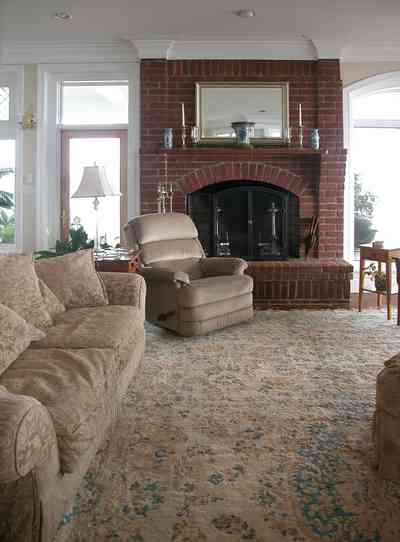 Sanders-Beach-585-Windrose_10+WEB.jpg:  living room, sofa, oriental rug, fireplace,