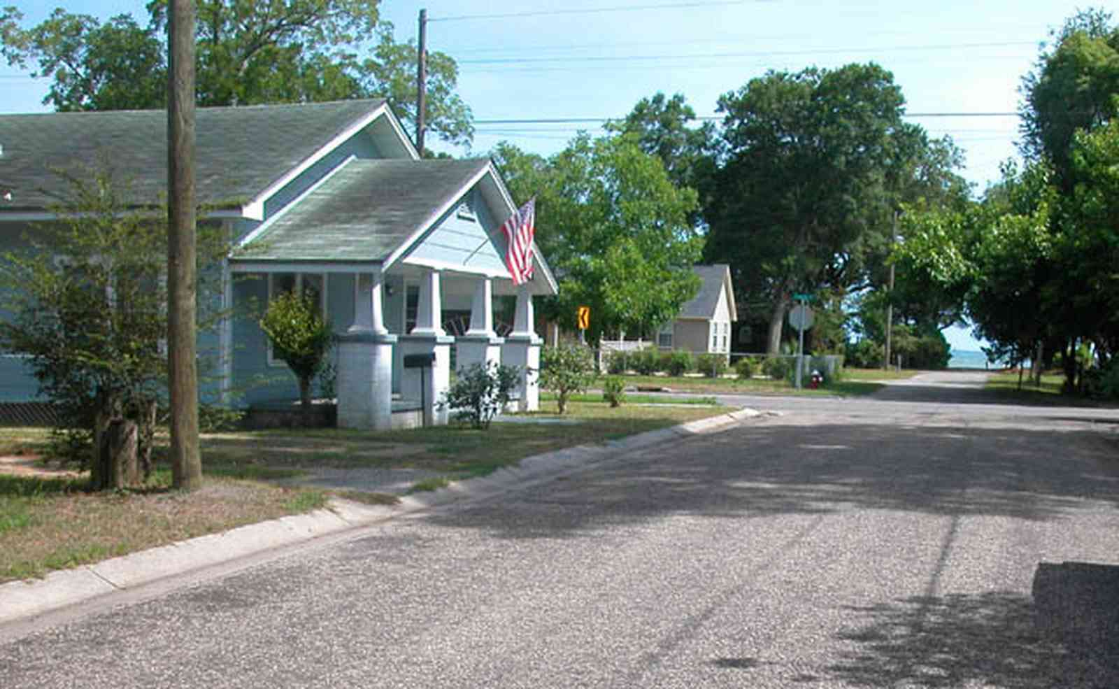 Sanders-Beach:-710-South-F-Street_03.jpg:  craftsman cottage, gulf of mexico, pensacola bay, american flag, quiet neighborhood, oak tree