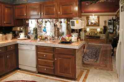 Scenic-Highway:-3780-Scenic-Ridge-Drive_02f.jpg:  kitchen, marble floor, oriental rug, wooden cabinets, opulent detail, mansion
