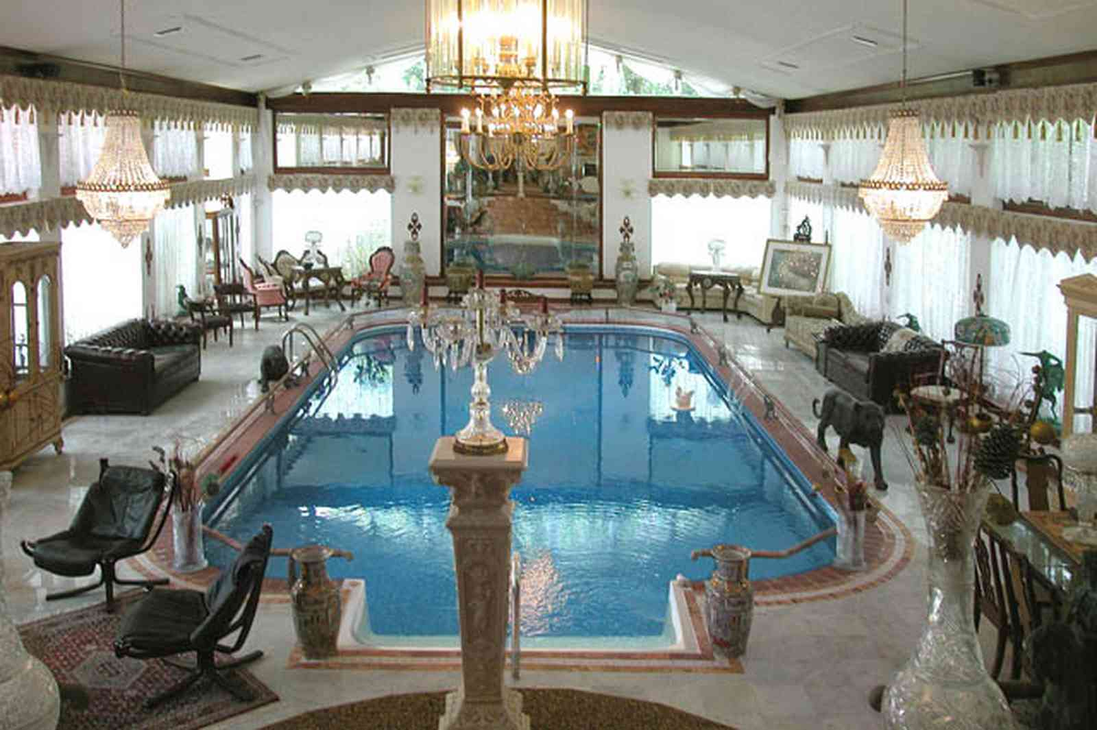 Scenic-Highway:-3780-Scenic-Ridge-Drive_04.jpg:  olympic swimming pool, living room, marble floors, chinese urns, tassels, oriental rug, pool in livingroom, inside swimming pool, french provincial furniture, crystal chandelier, swag curtains
