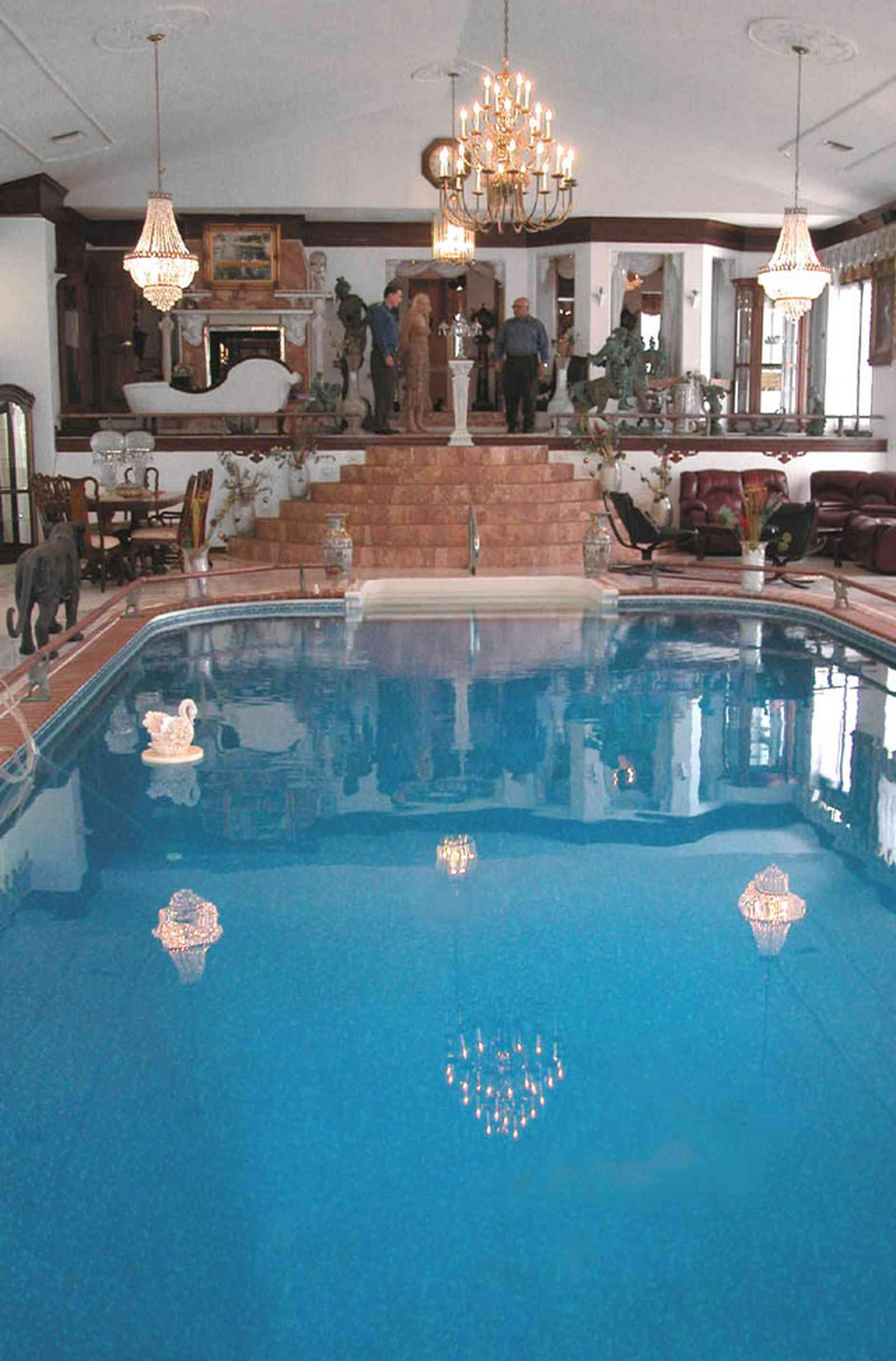 Scenic-Highway:-3780-Scenic-Ridge-Drive_05.jpg:  olympic swimming pool, living room, marble floors, chinese urns, tassels, oriental rug, pool in livingroom, inside swimming pool, french provincial furniture, crystal chandelier, reflection in pool, swan in water, marble steps, swag curtains