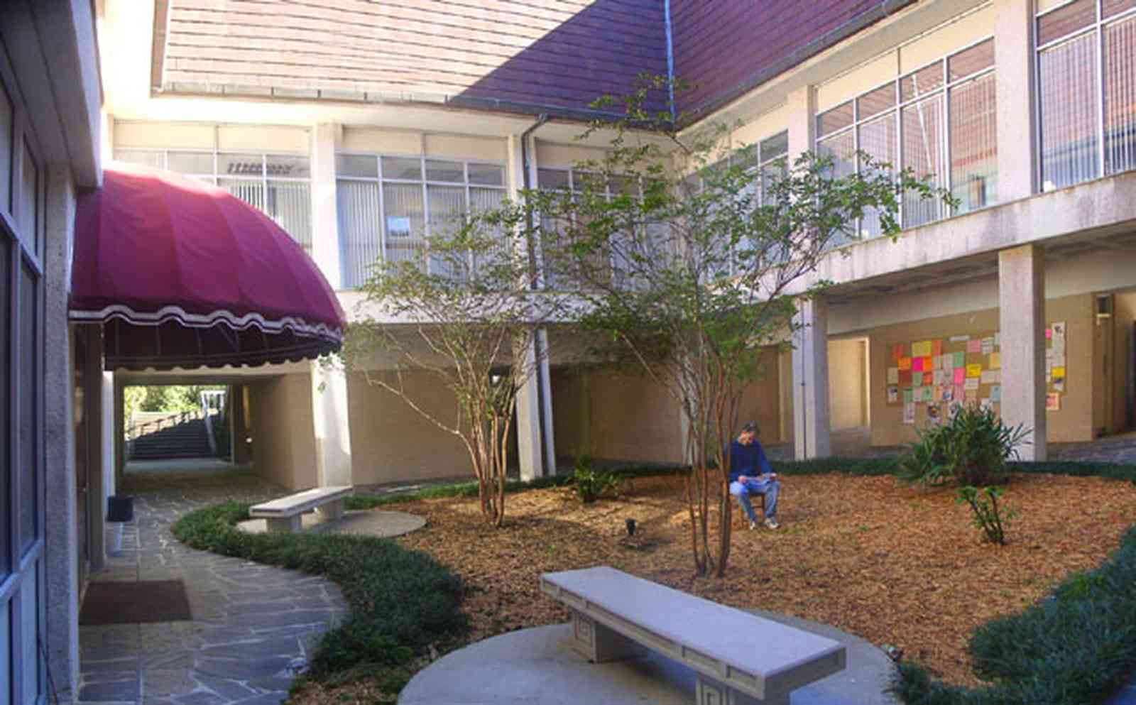University-Of-West-Florida:-Campus_03.jpg:  dorm building, bench, campus, student, university
