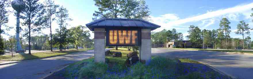 University-Of-West-Florida:-Campus_33.jpg:  university, sign, drive, pine trees