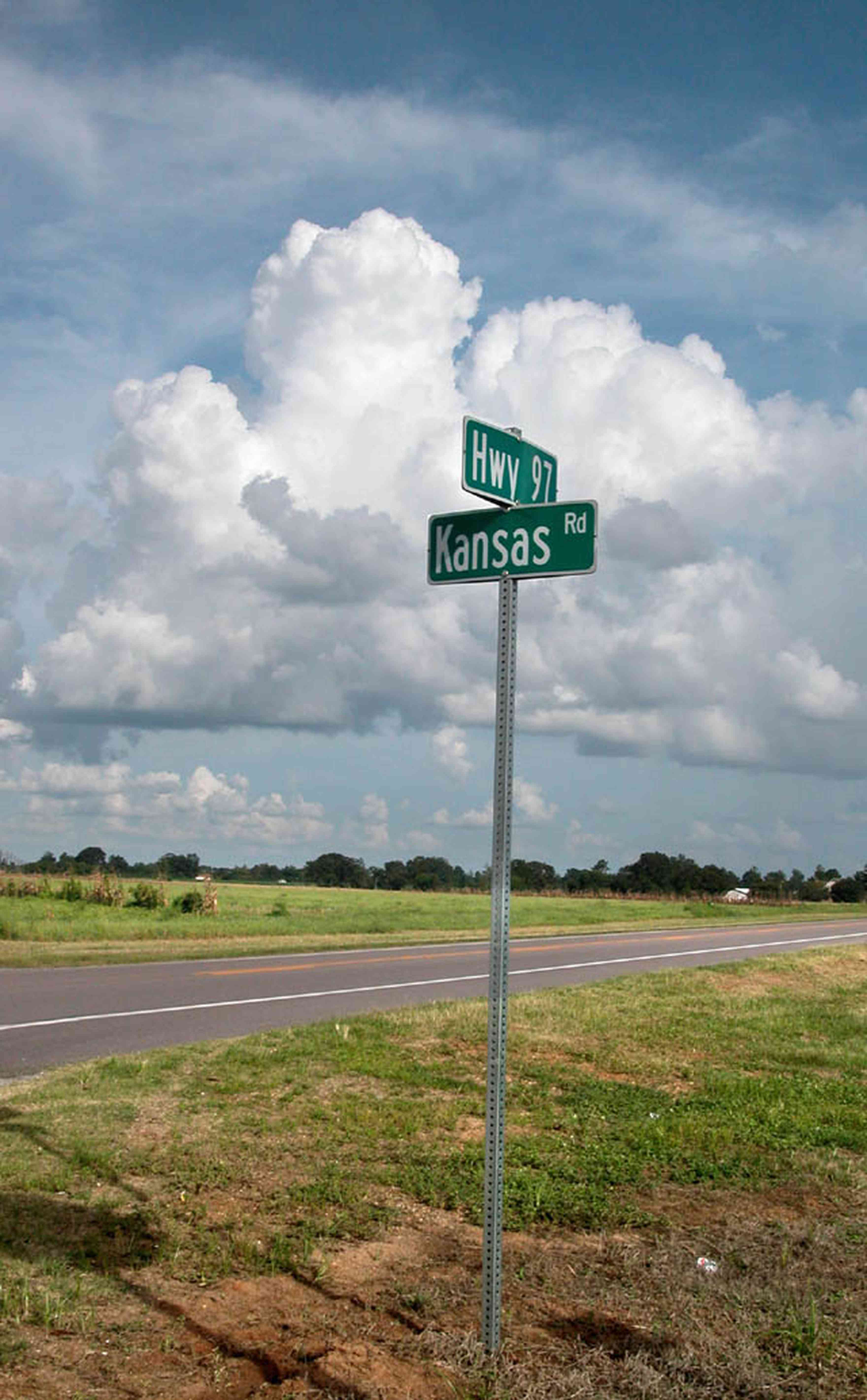 Walnut-Hill:-Kansas-Road:-Sign_00.jpg:  road sign, highway, two-lane road, country road, cumulus clouds, farm, farmland