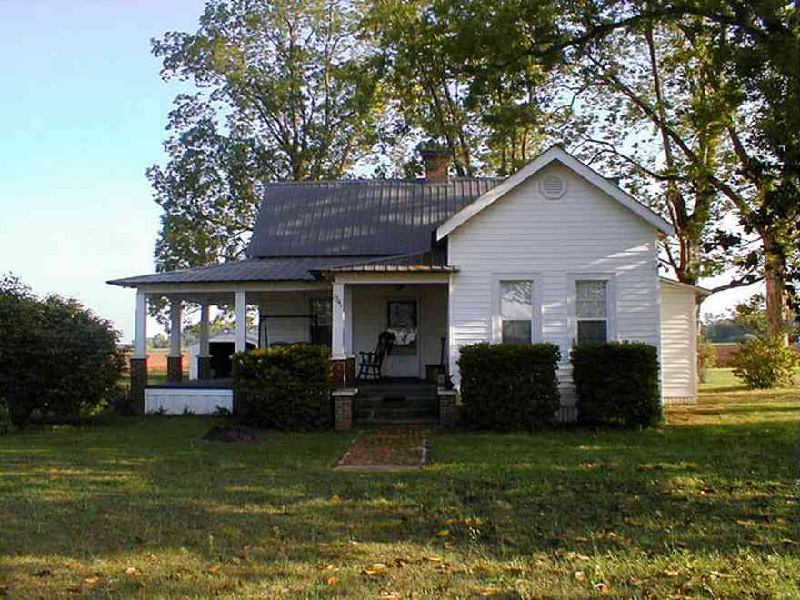 Walnut-Hill:-Ward-Farm_04.jpg:  farmland, craftsman style home, oak tree, magnolia tree, highway 97, corn field, menonite religious community, two-lane road, curving road, escambia county